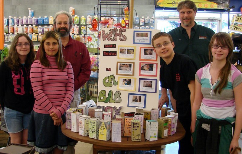 Wells Junior High School students, from left, Abby Hussey, Jessica Licardo, teacher Saul Lindauer, Ben Stevens, Wells Aubuchon Hardware store owner Jon Lord and Ashley Tosh pose by the students' in-store display.