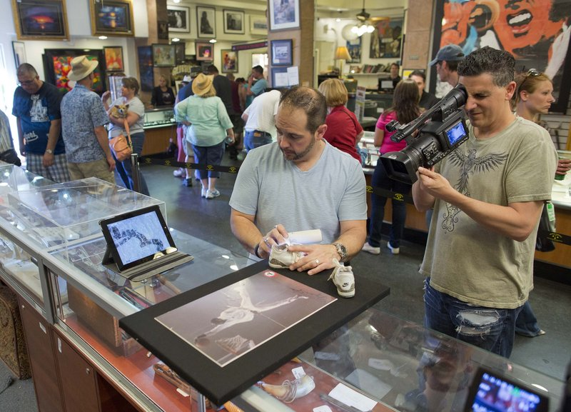 """Cameraman Joe Murgia shoots a close-up of Michael Jordan memorabilia that was brought in to the Gold & Silver Pawn shop in Las Vegas for the """"Pawn Stars"""" show on the History channel."""