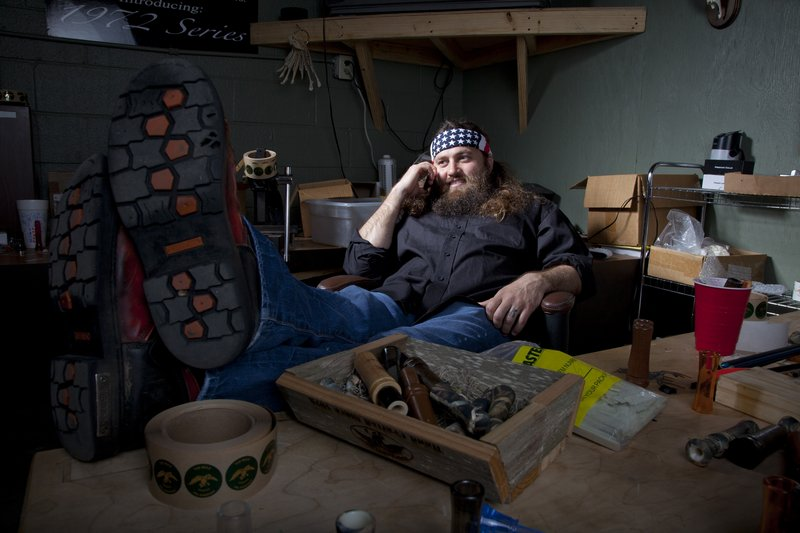 "Willie Robertson, star of A&E's ""Duck Dynasty,"" relaxes at the Duck Commander warehouse in West Monroe, La. Cameras follow Robertson and his family as they make duck calls, hunt or go camping."