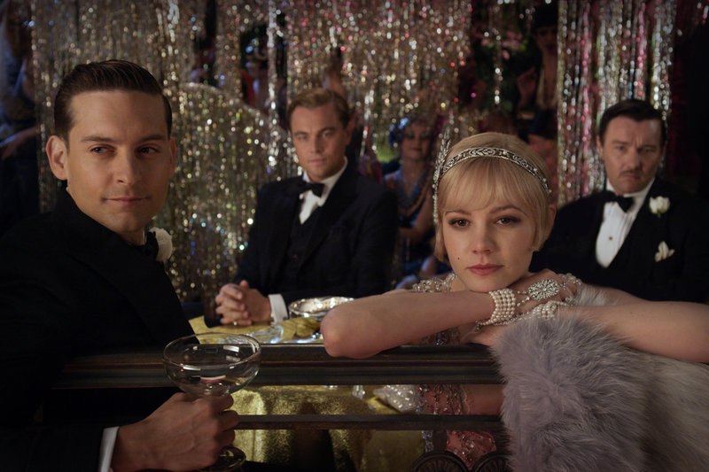 "Tobey Maguire, left, as Nick Carraway, Leonardo DiCaprio as Jay Gatsby, Carey Mulligan as Daisy Buchanan and Joel Edgerton as Tom Buchanan in ""The Great Gatsby."""