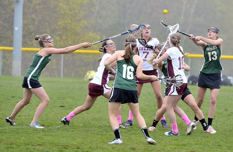 The ball was in the air and, as it turned out, so was fog. Then drizzle. Then a full-fledged rainstorm. So although Waynflete, in green, and Greely got to start their schoolgirl lacrosse game Thursday, the end came much too soon because of the weather. On to another day. A much sunnier day.