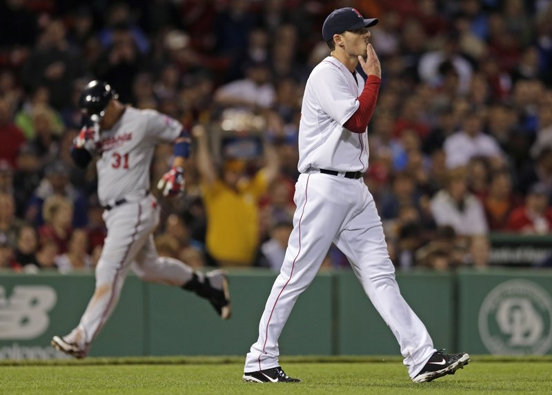 John Lackey heads back to the mound and Oswaldo Arcia heads home after hitting a two-run homer Thursday night for the Minnesota Twins against the Boston Red Sox.