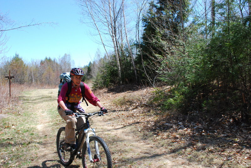 Eastern Maine mountain bike riders are grabbing hold of their destiny, and quite literally, dirt, having cleared a single track in Old Town last weekend on rugged terrain that just so happens to be ideal for adventurous cycling. The project has the blessing of the University of Maine – a significant divergence from the past.