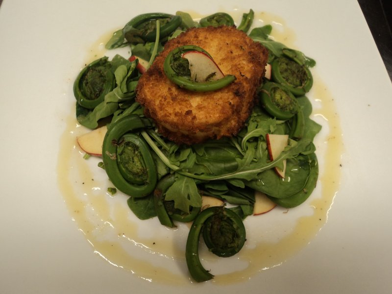 A goat cheese croquette with marinated fiddlehead salad from chef Mitchell Kaldrovich at Sea Glass at Inn By the Sea in Cape Elizabeth.