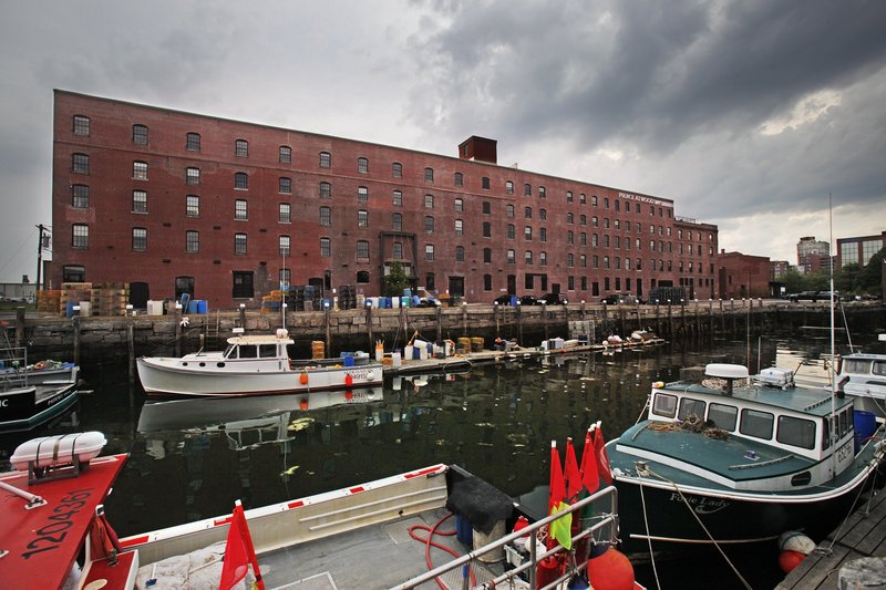 The ground floor of the Merrill's Wharf building has yet to attract a marine-use tenant nine months after Pierce Atwood moved into the upper floors.
