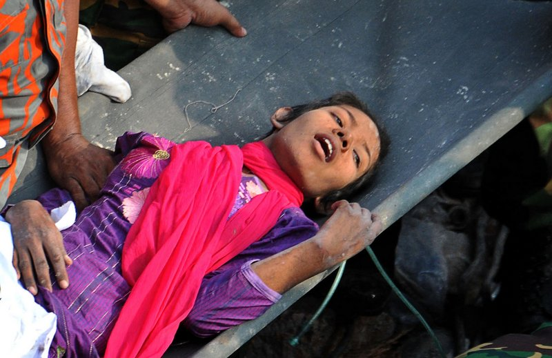 Reshma Begum lies on a stretcher Friday after being pulled from the basement of an eight-story garment factory that collapsed April 24 in Savar, near Dhaka, Bangladesh, killing more than 1,000 people. The rescue was broadcast on TV across the country.