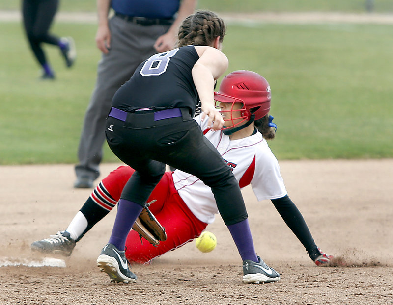 Laurine German of South Portland steals second base as Emily Robida of Marshwood attempts to control the ball.