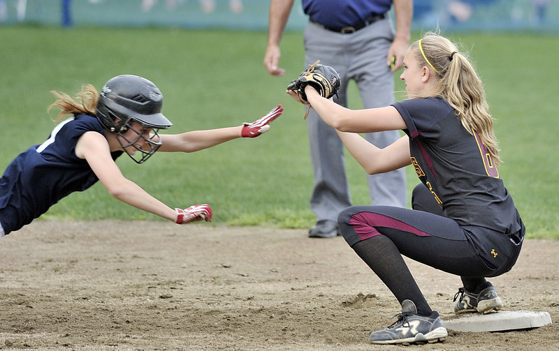 Carla Tripp of Fryeburg Academy is doubled off second base Friday as Tess Haler of Cape Elizabeth takes the throw after a pop up. Cape Elizabeth won, 9-6