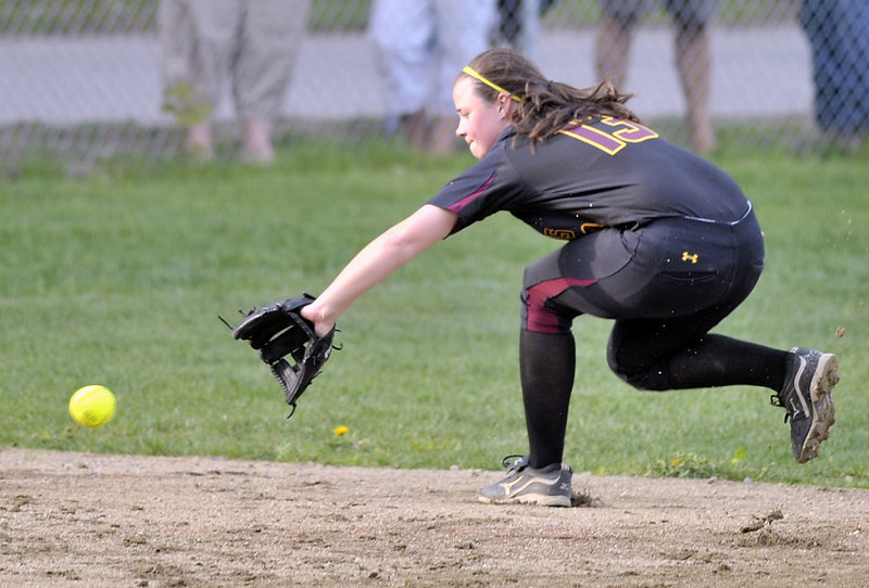 Ashley Tinsman of Cape Elizabeth goes into the shortstop hole Friday to snag a hard-hit grounder and prevent a run. The Capers remained undefeated and handed Fryeburg Academy its first loss with a 9-6 victory in a Western Maine Conference game.