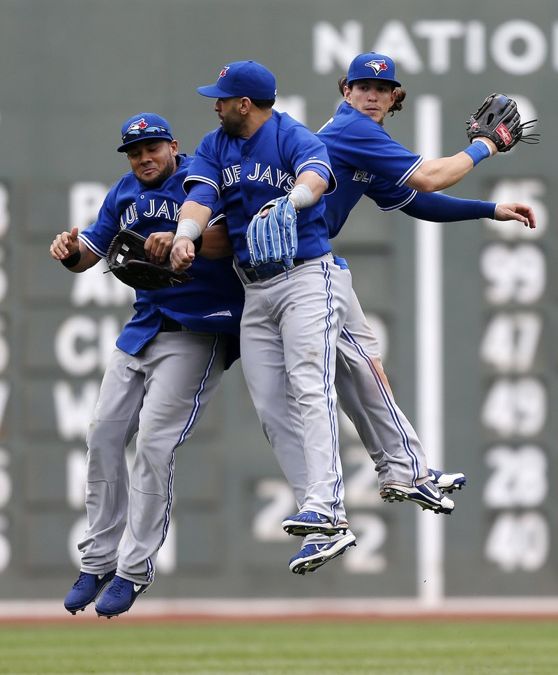 It's a rare celebration for Toronto's Melky Cabrera, Jose Bautista and Colby Rasmus, who whoop it up after the Blue Jays held on to beat the suddenly slumping Red Sox.