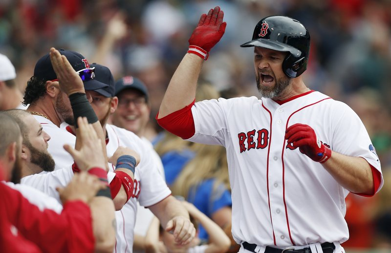 Boston's David Ross celebrates after scoring the tying run in the eighth inning, but the good times ended in the ninth when the Blue Jays scored the winning run.
