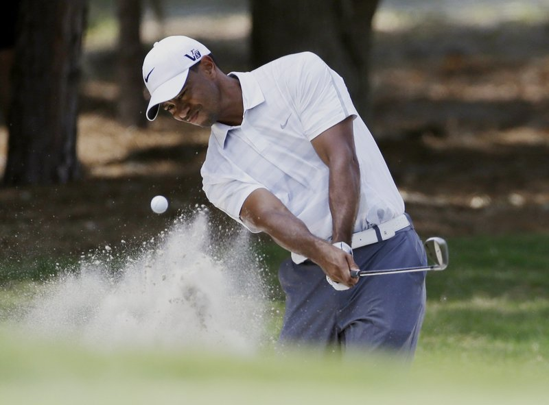 Tiger Woods hits from a sand trap Saturday on the second hole – the hole that caused a problem when Sergio Garcia felt he was distracted when Woods selected a club.