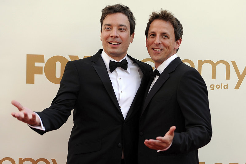 "Seth Meyers, right, will replace Jimmy Fallon, left, when Fallon replaces Jay Leno on ""Tonight"" next year."