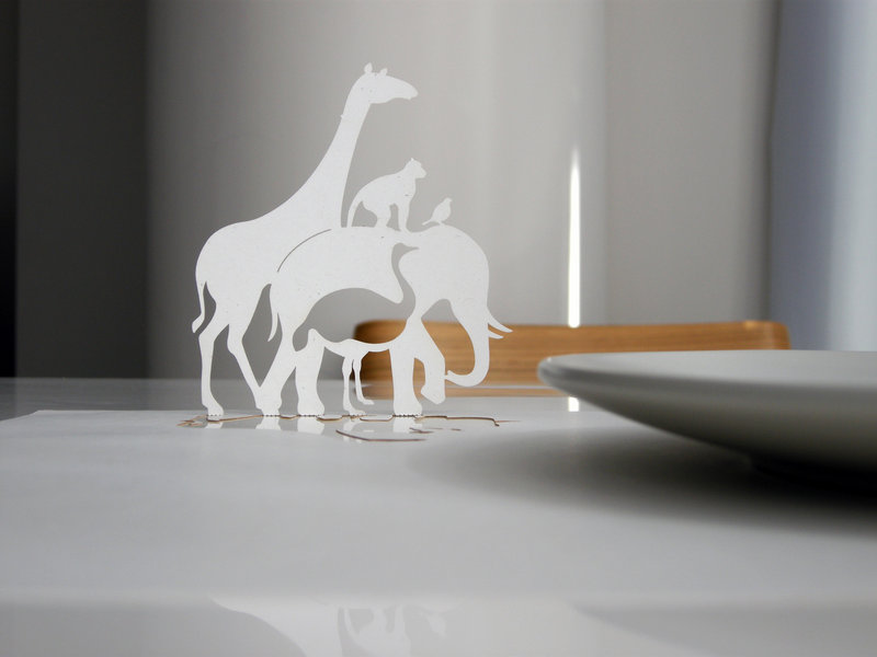 Artist Lian Ng makes paper placemats with clever cutout designs inspired by children's pop-up books.