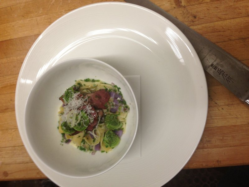 From chef Mitch Gerow at the East Ender in Portland, fiddleheads with egg noodles, tasso ham and purple potatoes.
