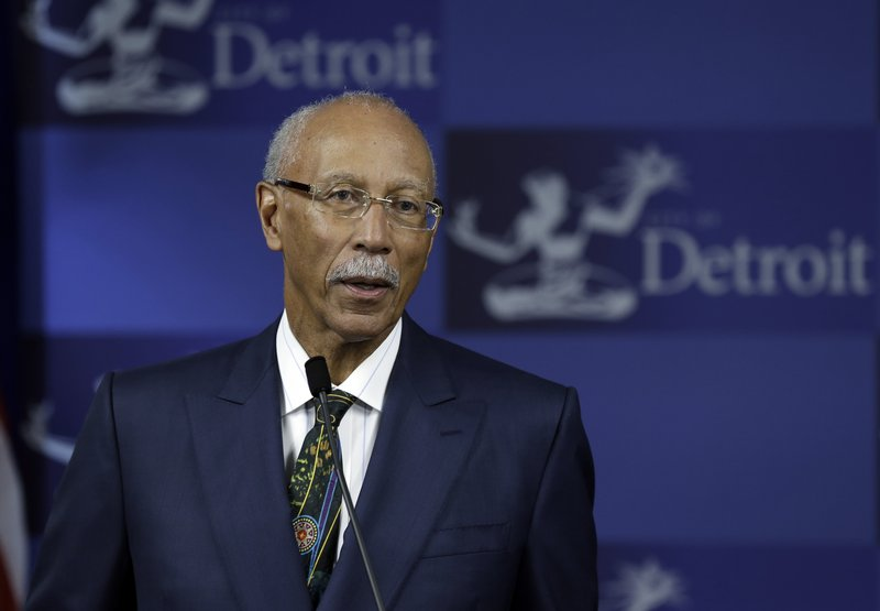 "Detroit Mayor Dave Bing discusses the city's finances during a news conference. An emergency manager's report says city operations are ""dysfunctional and wasteful."""