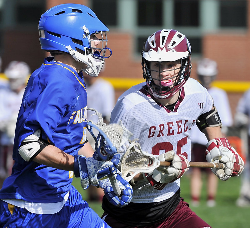 Falmouth's Brad Gilbert, left, is challenged by Greely's Fred Bower during the visiting Yachtsmen's 12-3 win Monday. Falmouth improved to 6-2 while Greely dropped to 5-3.