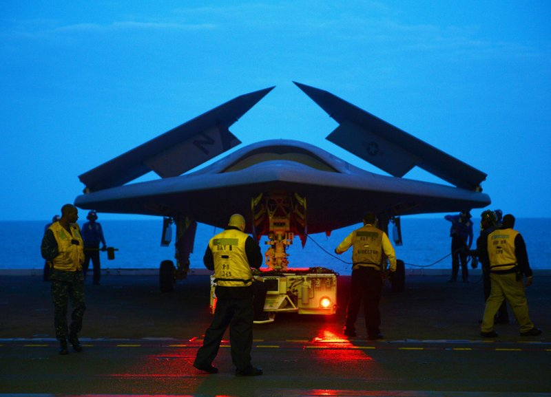 The X-47B combat drone is prepared for flight aboard the USS George H.W. Bush aircraft carrier on Monday. The X-47B, shown in a photo provided by the U.S. Navy, more closely resembles a fighter jet in size, appearance and capabilities than the much smaller drones that are currently being used by the military.