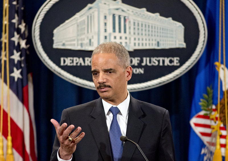 Attorney General Eric Holder is questioned at a news conference Tuesday about the Justice Department's gathering of phone records from the Associated Press.