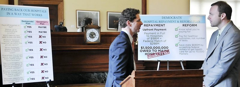 Senate President Justin Alfond and House Speaker Mark Eves confer March 11 after unveiling a plan to combine a decision on Medicaid expansion with a proposal to pay hospital debt. Gov. LePage has said that the plan is an effort to link disparate issues.