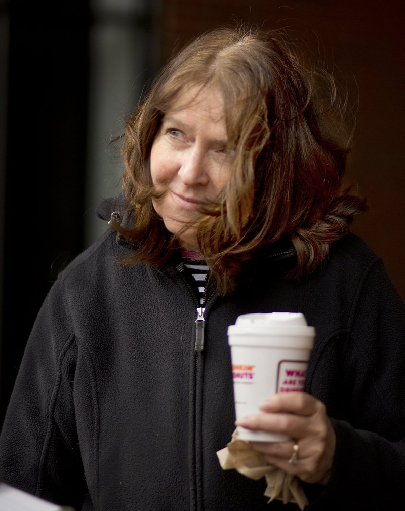 Maryellen O'Toole of Scarborough carries a cup of coffee from a Portland Dunkin' Donuts. A reader wonders if the city of Portland's proposed ban on Styrofoam packaging would apply to things like the cups, which are made not of Styrofoam but of a different material – expanded polystyrene,