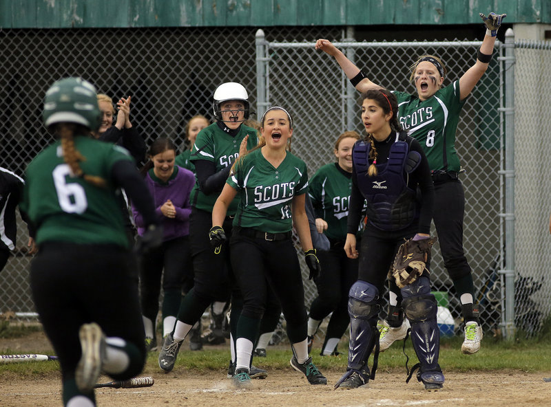 Allison Pillar heads for home as her Bonny Eagle teammates prepare to welcome her after an inside-the-park home run Wednesday against Marshwood. The game was called after seven innings because of rain with the score tied 5-5.
