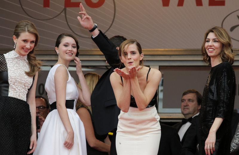 Emma Watson blows kisses at the 66th annual Cannes Film Festival, in Cannes, France, Thursday.