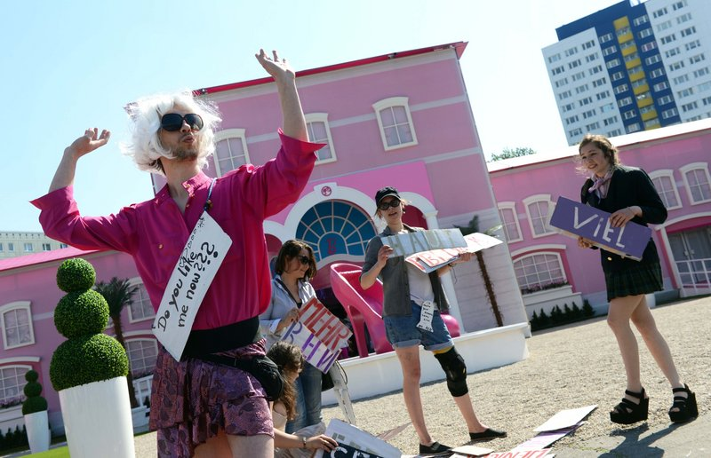 "Demonstrators protest in front of the ""Barbie Dreamhouse"" in Berlin on Thursday. The theme house in Berlin is the second after a similar one opened recently in Florida."