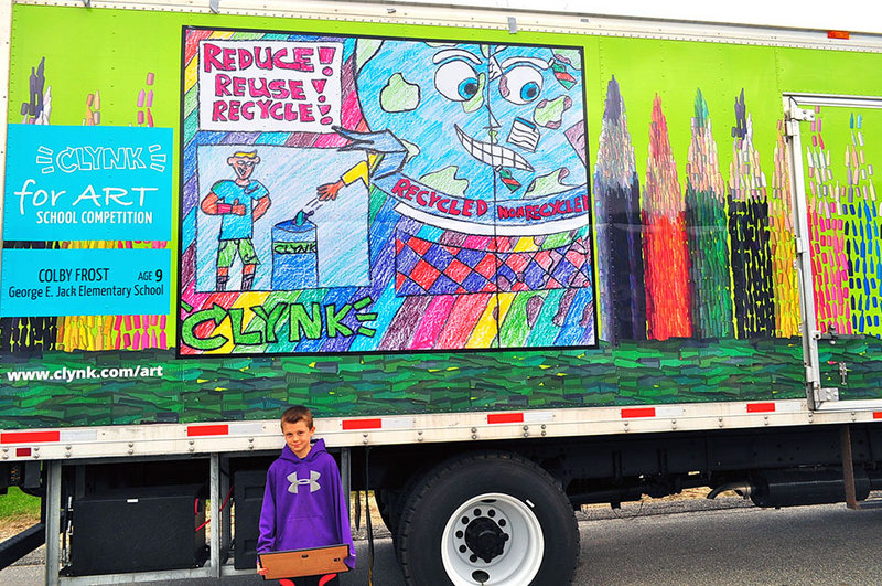 "Fourth-grader Colby Frost has won the George E. Jack School's recent ""Clynk For Art"" Competition. Colby poses in front of a Clynk recycling truck, decorated with his winning artwork displayed on both sides."