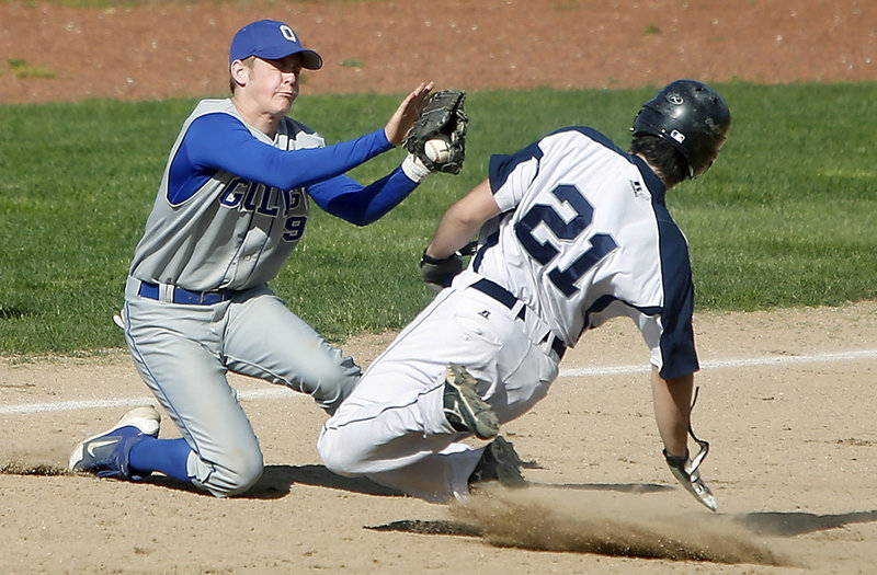 Old Orchard Beach third baseman Sean McDermott can't hold onto the ball as Poland's Jake Simard slides in safely Thursday. Poland scored a pair of late runs to hold off Old Orchard Beach 8-7 in the matchup between Class B and Class C teams.