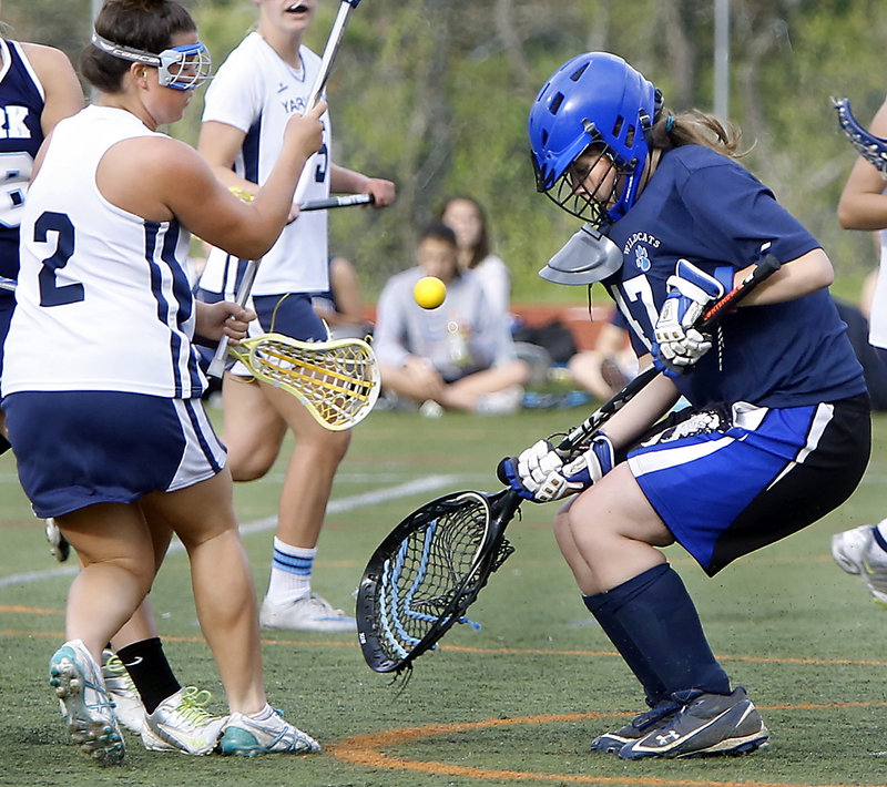 York goalie Livvy Golini blocks the shot of Ali Merrill of Yarmouth in the first half Thursday.