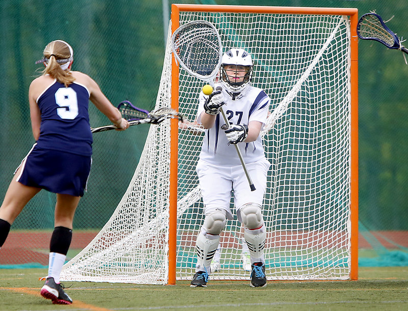 Lizzy Wagner of York watches as her shot is about to go past Yarmouth goalie Nicki Hickey in the first half Thursday. Wagner scored four goals as York took a 12-9 win.
