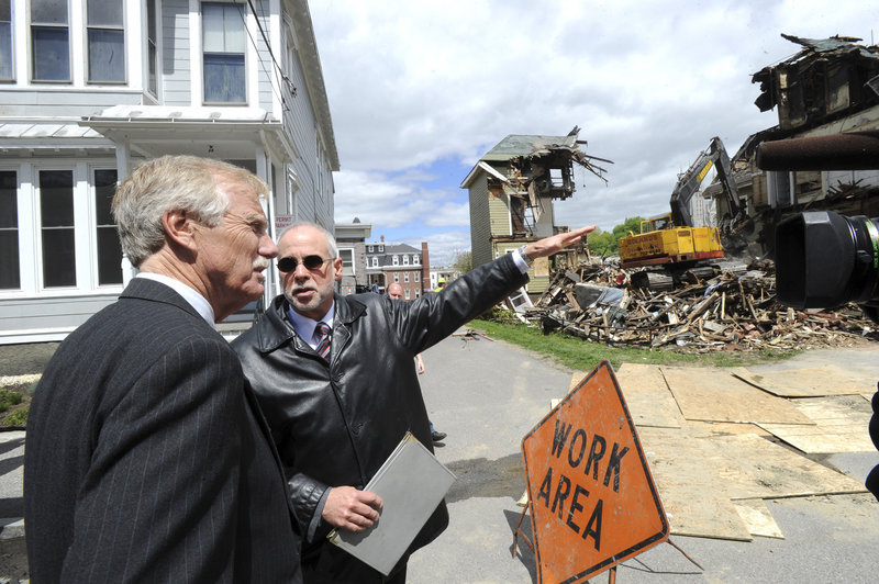U.S. Sen. Angus King tours fire sites in Lewiston, including 80-82 Pine St., where he was briefed by Assistant City Administrator Phil Nadeau.