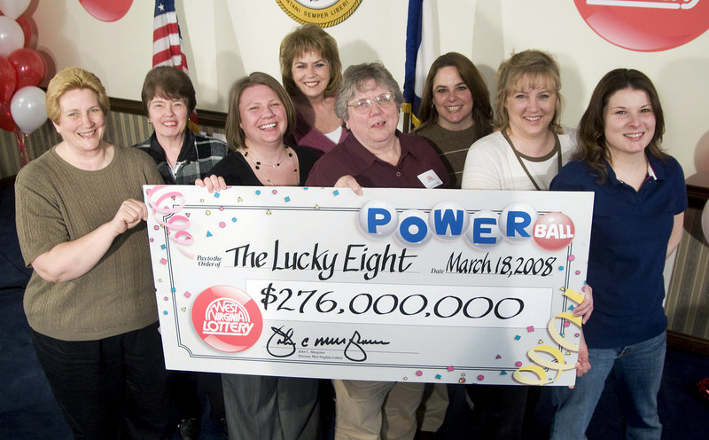 Eight co-workers in the Monongalia County Tax Office claim their $276 million Powerball prize in Charleston, W.Va., in 2008. Workplace pools for big jackpots are often fraught with controversy, resulting in lawsuits, broken friendships and delayed payouts.