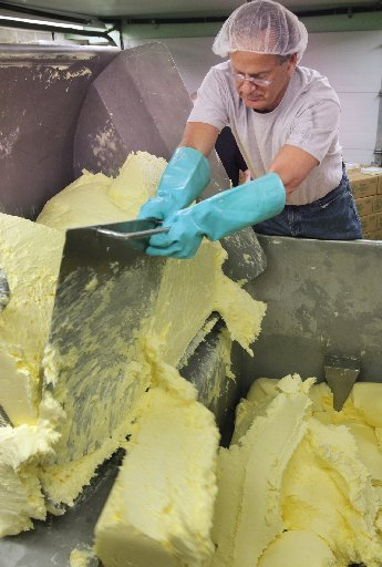 Dan Patry produces butter at Kate's Homemade Butter in Old Orchard Beach. Neighbors have complained that Kate's should not be operating in a residential neighborhood.