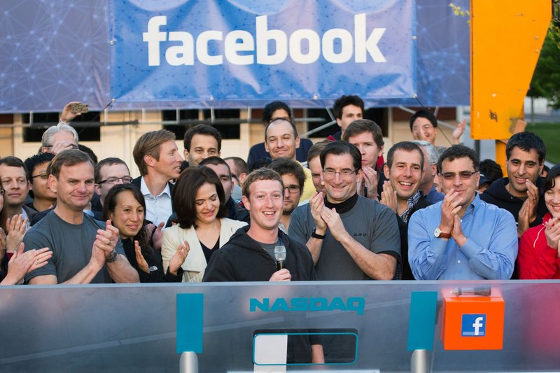 CEO Mark Zuckerberg, center, rings the opening bell of the Nasdaq stock market, on May 18, 2012.