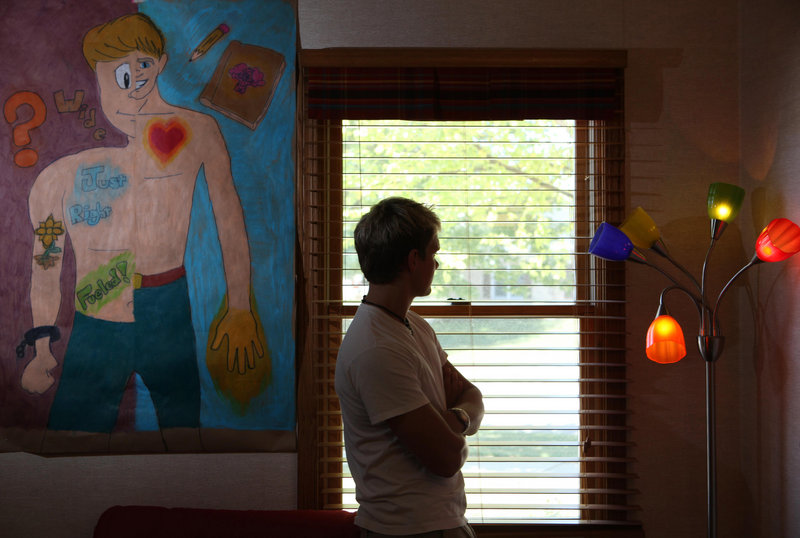 A psychiatric patient stands next to a painting he did at a hospital in Elgin, Ill. Even the head of the U.S. National Institute of Mental Health has complained that the proposed new manual for diagnosing mental disorders lacks scientific validity.