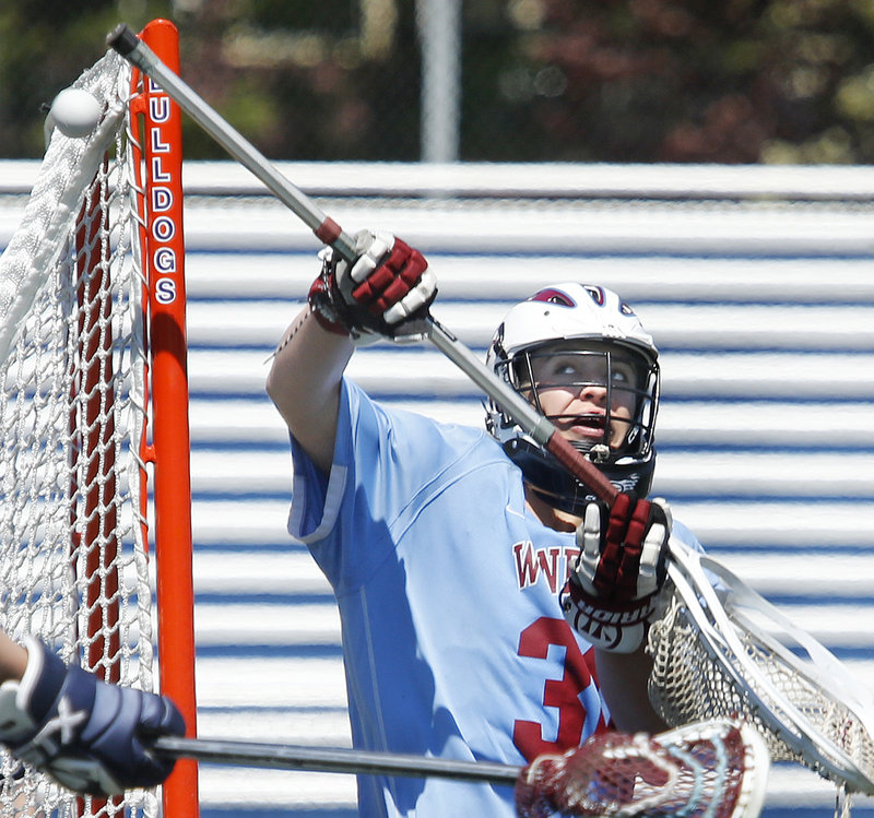 Windham goalie Frank Taylor makes a save during Saturday's lacrosse game against Portland at Fitzpatrick Stadium. Portland won, 5-3.