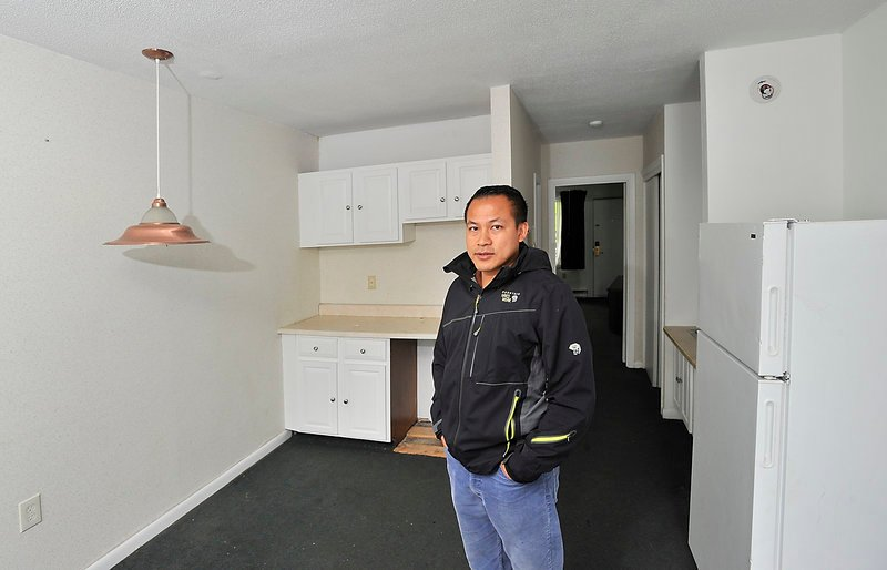 Tim Ly, the owner of MaineLy Property Management, talks about his efforts to satisfy safety requirements in the Route 1 apartment complex he manages. He's standing in one of the rooms that need upgrading so he can get an occupancy permit.