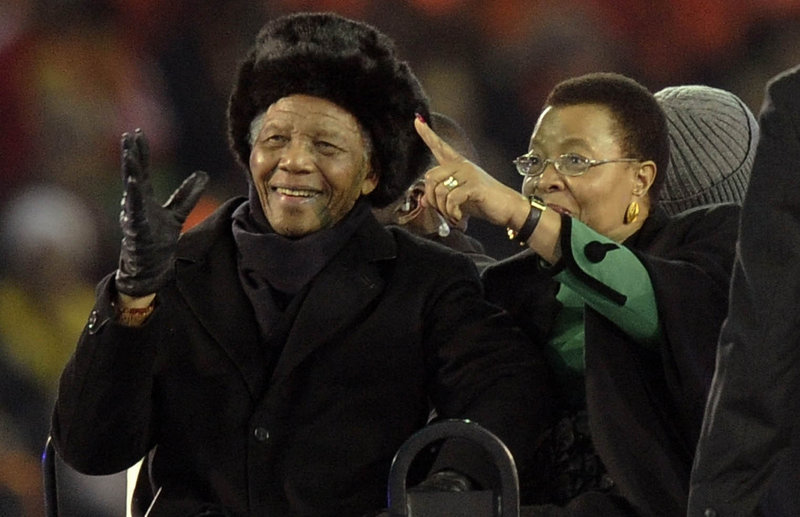 Former South African President Nelson Mandela and his wife, Graca Machel, attend the final of the FIFA World Cup Soccer Tournament in Johannesburg on July 11, 2010, his last public appearance. Mandela, now old and frail, lives in seclusion in his Johannesburg home, and the fighting over his image and legacy has already begun.