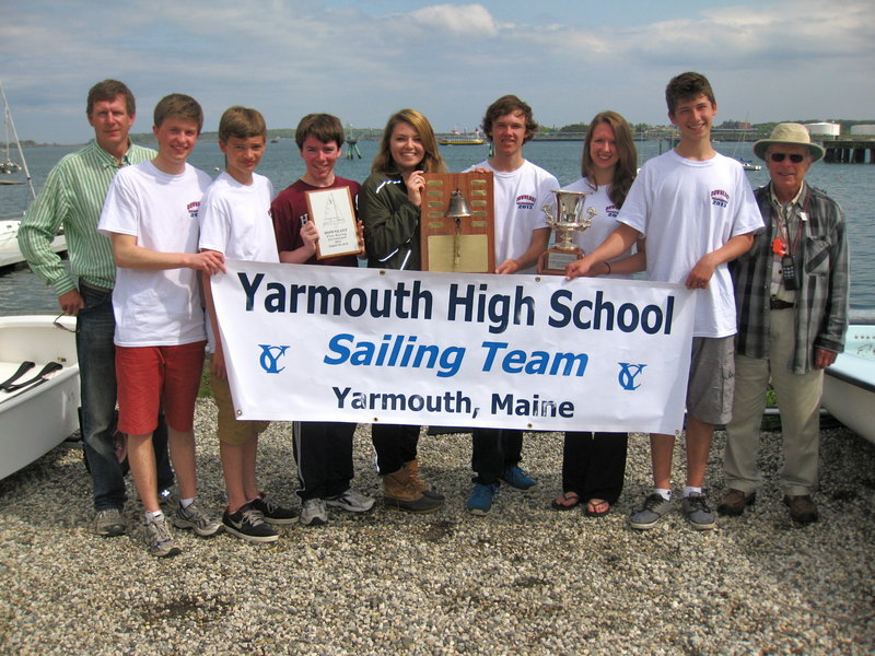 Yarmouth High's sailing team won the Downeast Championship and Maine Schools Championship this past weekend at Maine Maritime Academy. Pictured from left to right: assistant coach Doug Baker, co-captain Sam Alexander, Ethan Merrill, Ben Palmer, Anna Bernard, co-captain Tim Morse, Haley Estabrook, Teo Scott, and head coach Mike Horn. Absent from photo: Kaeleigh Morton.
