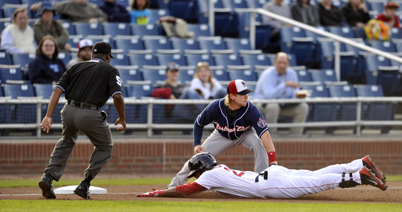 Portland's Tony Thomas slides safely into third base with a triple as Manchester infielder Ryan Schimpf waits for a late throw during the Fisher Cats' victory over the Sea Dogs Monday evening at Hadlock Field.