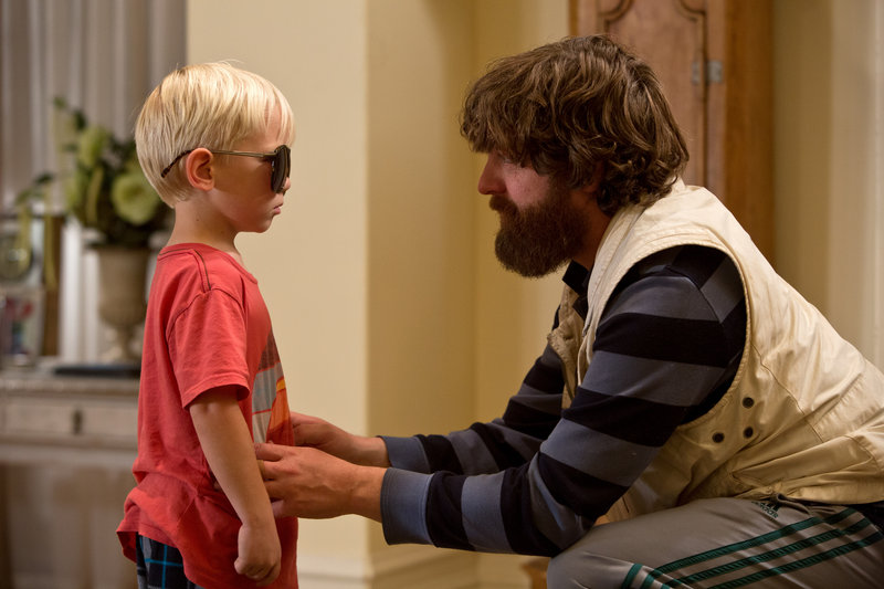 "Grant Holmquist as Tyler/Carlos, left, and Zach Galifianakis as Alan appear in a scene from ""The Hangover Part III."""