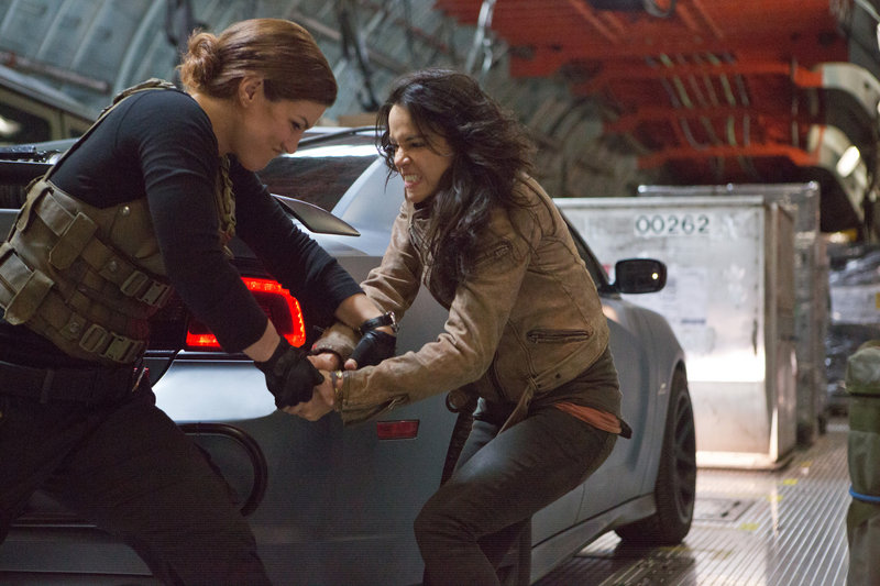 "Gina Carano, left, and Michelle Rodriguez grapple in the latest of the ""Fast & Furious"" action films."