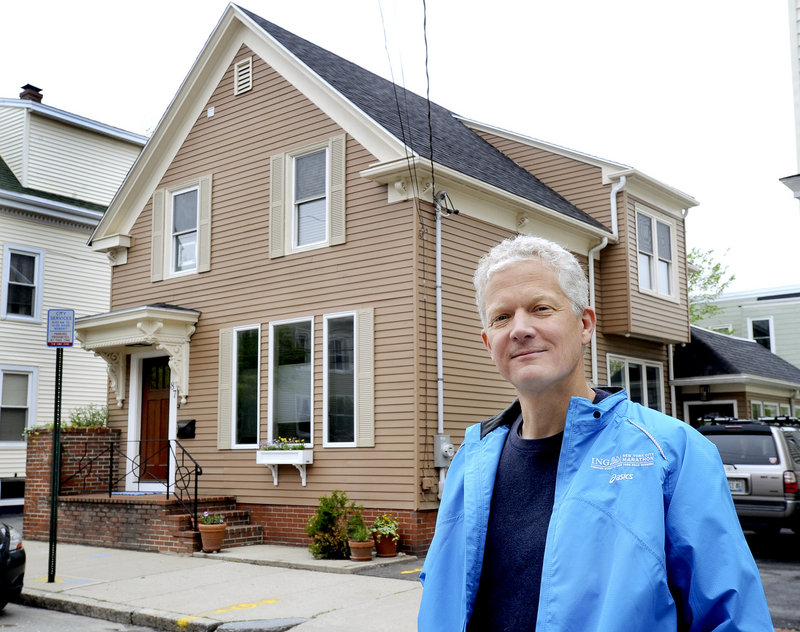Matthew Kennedy stands in front of his newly purchased home on Beckett Street in Portland on Wednesday, May 22, 2013. Maine's residential real-estate market is heating up.