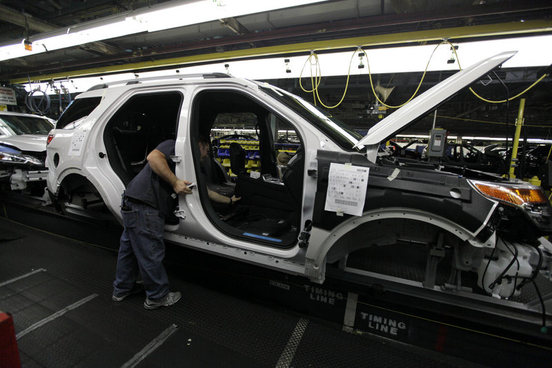 Workers on at many of Ford's assembly plants, like this one in a 2010 file photo, will have less summer break this summer as car makers ramp up their capacity. Chrysler and General Motors also say they will take one week off at many plants instead of the usual two weeks off.