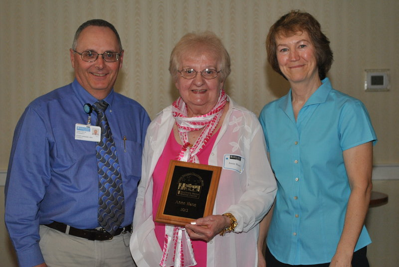Southern Maine Medical Center's pharmacy pirector Joe Bernier, left, and pharmacist Susan O'Connell, right, present Anne Hane the Lauren Shulman Volunteer of the Year award for 2013. Hane has been a volunteer at SMMC for eight years, spending more than 4,000 hours helping in the pharmacy.