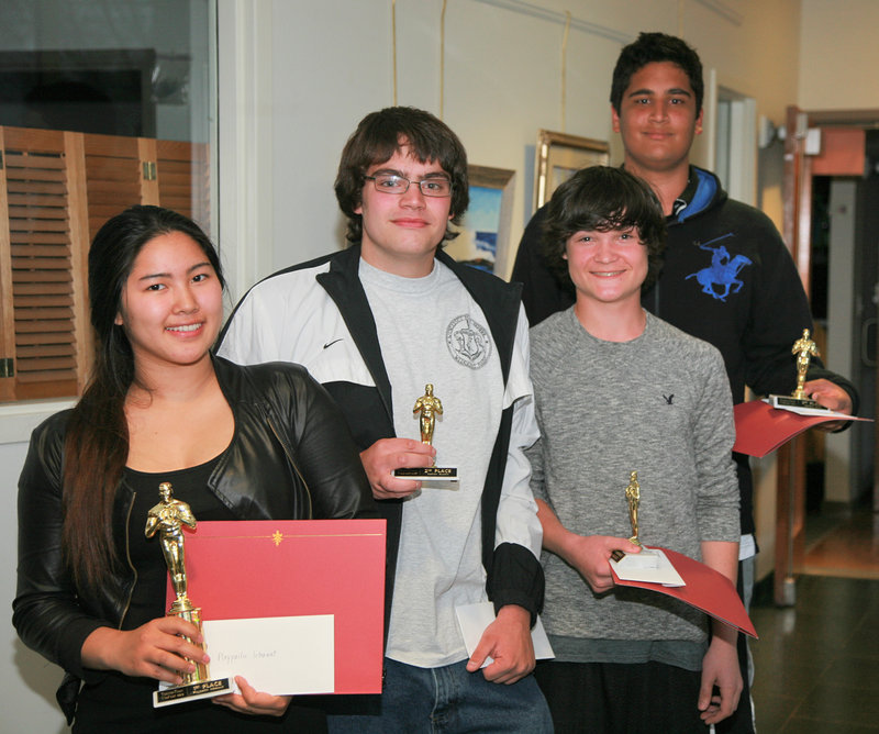 Teen2Teen VidFest top four winners pose after receiving their awards during a special screening night of their short public service announcement films. Pictured from left are Ploypailin Intarawut, Nathan Austin, Aidan Shadis and Sammy Zaidi.