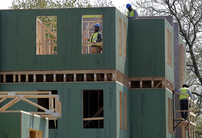 Workers are seen at the construction site of a new housing complex in Trenton, N.J., in April. U.S. sales of new homes rose in April, the Commerce Department reported Thursday.