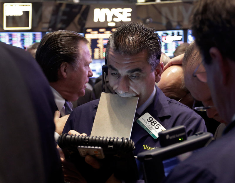 Trader Vincent Quinones works on the floor of the New York Stock Exchange at the close of trading Thursday.